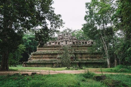 Ancient temples of Angkor, Siem Reap, Cambodia covered by a lot of vegetation and surrounded by a beautiful green forest - World Heritage by UNESCO in 1992 - Inferior view.