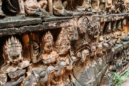Buddhist stone sculptures at Ankgor Thom in Cambodia - UNESCO World Heritage Site 1992 - Close-up