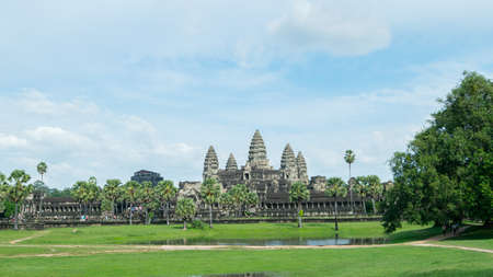 Beautiful landscape photo of Bayon temple in the city of Ankgor Thom surrounded by a beautiful green forest and under a clear blue sky in Cambodia - World Heritage by UNESCO in 1992 - Landscape photo