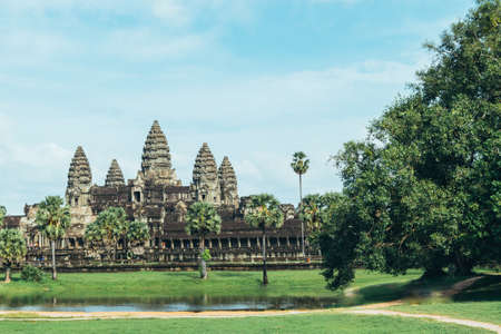 Beautiful and colorful photo of Bayon temple in the city of Ankgor Thom surrounded by beautiful green forest in Cambodia - Landscape photo