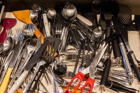 Set of clean kitchen utensils in drawer. Top view Stockfoto