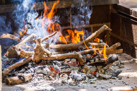 Hot coals in the fire. Photo of an indoor wood fire grill burning