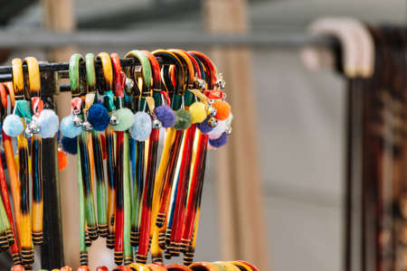 Selective focus. Wooden colorful little canes handmade