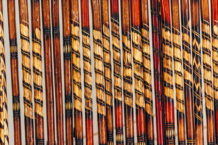 Close up of wooden sticks handmade with different colors and details. Good for background