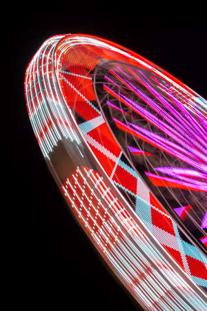 Abstract Motion Blur of Ferris Wheel In Amusement City Park