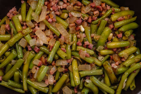 Close up. Green beans and serrano ham. Spanish cuisine. Food an texture concept.