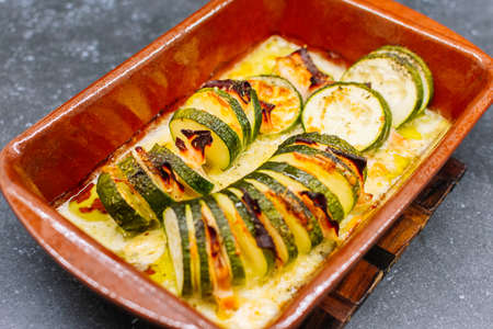 Delicious Baked Stuffed zucchini with cheese and turkey ham. Selective focus. Stock fotó
