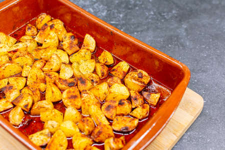 Selective focus of potatoes baked in a baking dish.