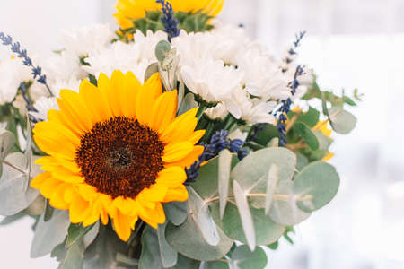 Close up of flowers. Lavander, sunflowers, and white chrysanthemums. Bouquet for decoration