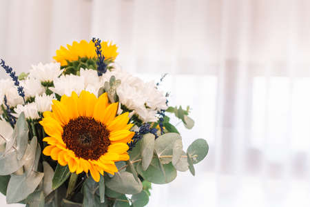 Beautiful bouquets of flowers. Lavander,sunflowers, and white chrysanthemums. White background Stock fotó