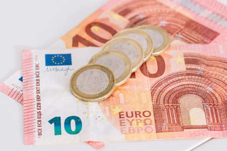 Money euro coins and banknotes. ten euro bills banknotes, with euro coins on white background.
