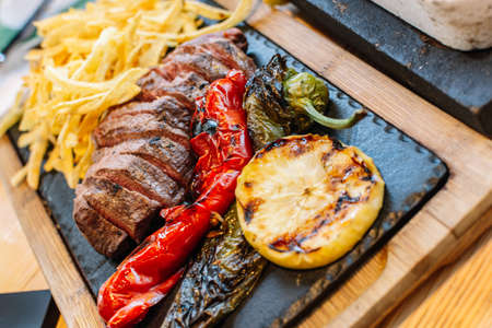 grilled vegetables and meat. Potatoes, peppers, barbecue steak. food close-up. Stock fotó