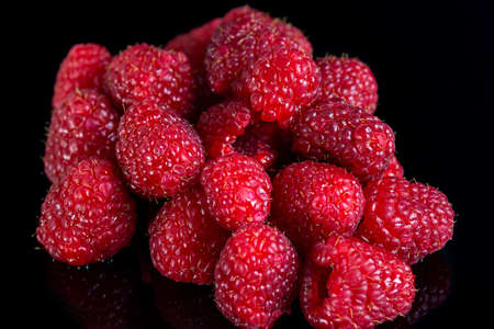 Fresh raspberries close up on a black background