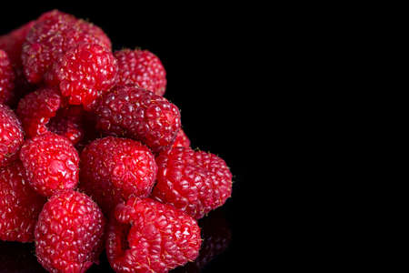 Fresh raspberries close up on a black background. Selective focus Stock fotó