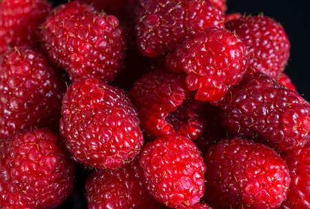 Fresh raspberries close up. Selective focus. Healthy food background