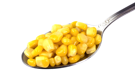 corn and a spoon, composition isolated over the white background