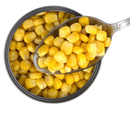 Opened corn bank with spoon filled with corn, isolated on a white background