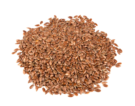Flax seeds isolated on white background. Also known as Linseed, Flaxseed and Common Flax. Pile of grains, isolated white background. Standard-Bild