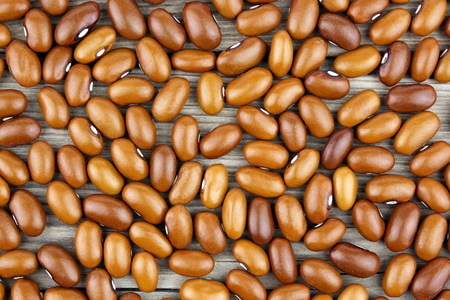 Colored haricot beans closeup on a background, top view, beans background.