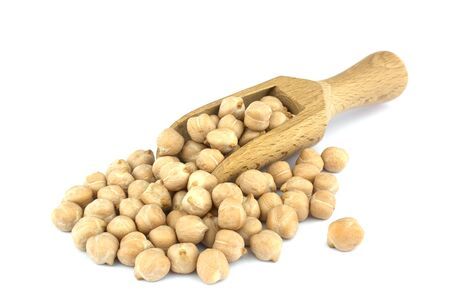 Small wooden scoop with chickpeas seen isolated on white background. healthy food