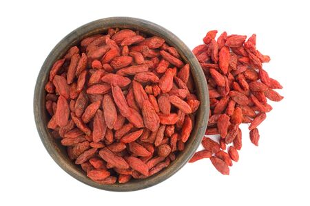 Dried goji berries in ceramic bowl isolated on a white background.