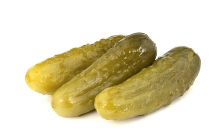 Some marinated cucumbers isolated on the white background Imagens