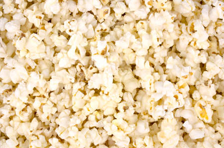 Scattered salted popcorn, texture background, tasty, natural