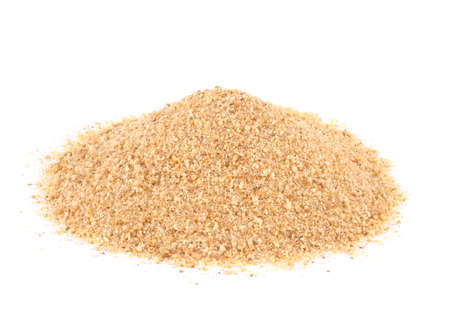 Pile of bread crumbs isolated on white. natural food ingredient.