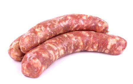 Raw pork sausage isolated on white background. Foto de archivo
