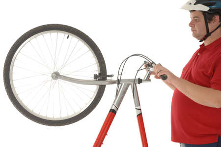 static bike: Over weight men working out with a bicycle