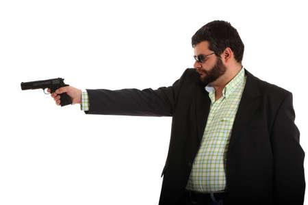 man holding gun wearing sunglasses photo
