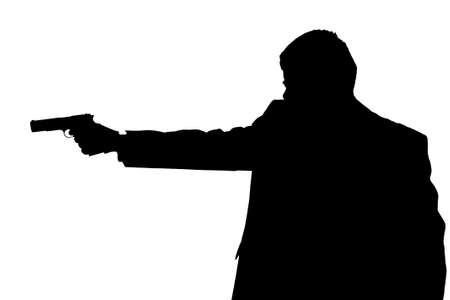 armed services: man holding gun silhouette Stock Photo