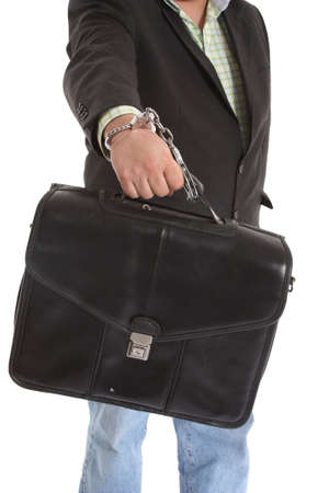 Security transporter handcuffed to a leather case photo
