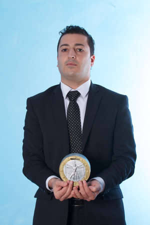 bridging the gap: business man with coin replica