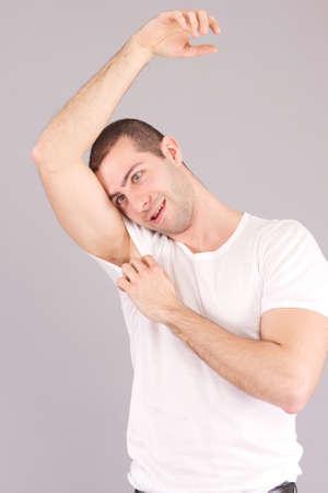 perspiring: Man surprised Portrait looking at sweat stain perspiring Stock Photo