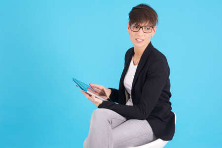 Business woman using touchscreen tablet  photo
