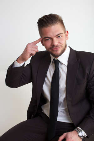 businessman pointing head photo