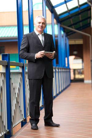 bridging the gap: businessman with digital tablet