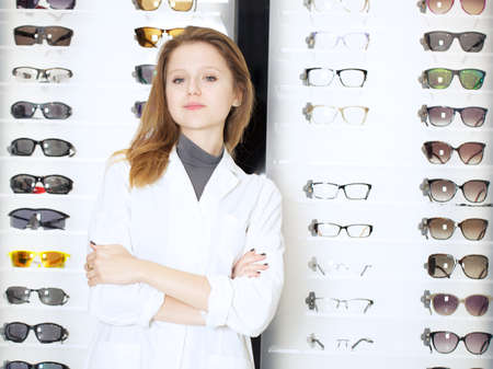 opthalmology: young beautiful optometrist
