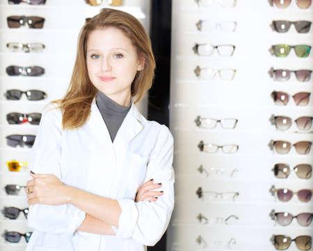 opthalmology: young beautiful optometrist