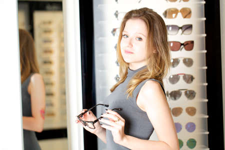 Young woman in glasses store photo