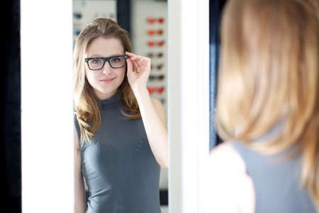 Beautiful woman at glasses store photo
