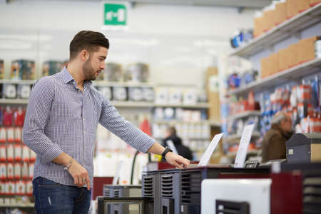 only man: working in hardware store