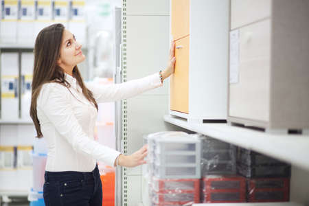 hardware: woman in hardware store Stock Photo