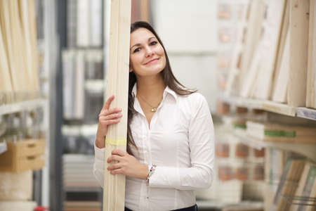 hardware: woman at hardware store Stock Photo
