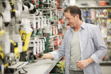 hardware store: adult man in hardware store