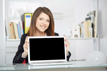 blank screen: young businesswoman showing blank screen Stock Photo