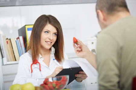 dietology: young nutritionist Stock Photo