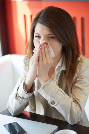 sniffles: woman with the flu Stock Photo