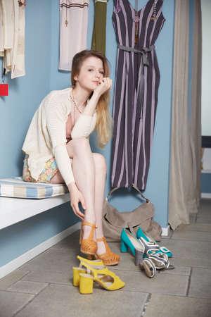 legs crossed on knee: shoes store